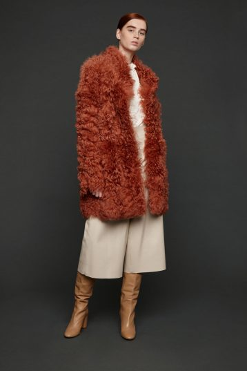 curly shearling coat in canteloupe orange | Women | Gushlow & Cole