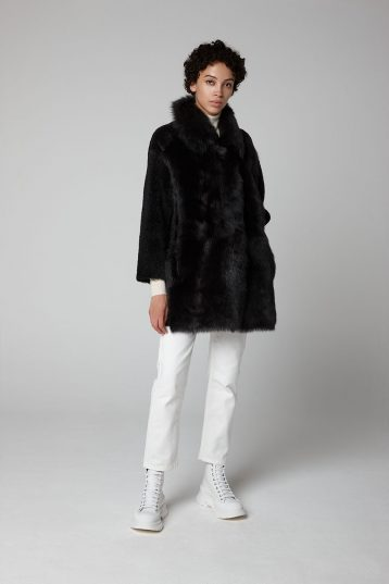Black Relaxed Fit Mixed Shearling Taper Coat - model full length wool out - women | Gushlow & Cole